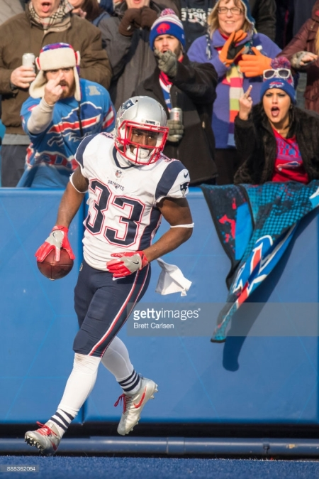 ORCHARD PARK, NY - DECEMBER 03: Dion Lewis #33 of the New England Patriots returns to the line of scrimmage during the second quarter as Buffalo Bills fans gesture at New Era Field on December 3, 2017 in Orchard Park, New York. New England defeats Buffalo 23-3. (Photo by Brett Carlsen/Getty Images) *** Local Caption *** Dion Lewis