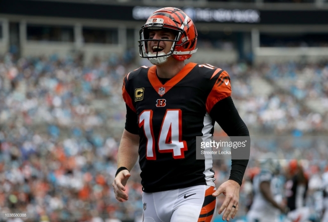 CHARLOTTE, NC - SEPTEMBER 23: Andy Dalton #14 of the Cincinnati Bengals reacts after throwing a touchdown pass against the Carolina Panthers in the third quarter during their game at Bank of America Stadium on September 23, 2018 in Charlotte, North Carolina. (Photo by Streeter Lecka/Getty Images)