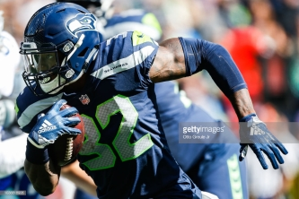 SEATTLE, WA - SEPTEMBER 23: Running Back Chris Carson #32 of the Seattle Seahawks runs against the Dallas Cowboys at CenturyLink Field on September 23, 2018 in Seattle, Washington. (Photo by Otto Greule Jr/Getty Images)