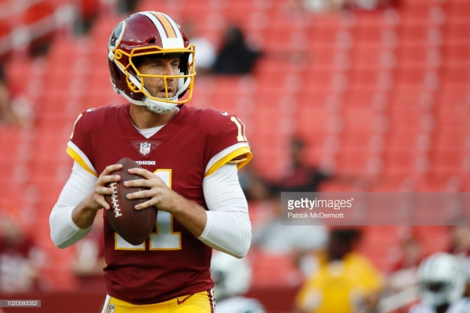 LANDOVER, MD - AUGUST 16: Quarterback Alex Smith #11 of the Washington Redskins warms up before playing against the New York Jets in a preseason game at FedExField on August 16, 2018 in Landover, Maryland. (Photo by Patrick McDermott/Getty Images)