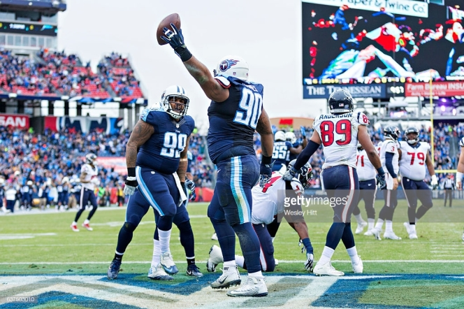 NASHVILLE, TN - JANUARY 1: DaQuan Jones #90 celebrates with Jurrell Casey #99 of the Tennessee Titans after recovering a fumble for a touchdown against the Houston Texans at Nissan Stadium on January 1, 2017 in Nashville, Tennessee. The Titans defeated the Texans 24-17. (Photo by Wesley Hitt/Getty Images)