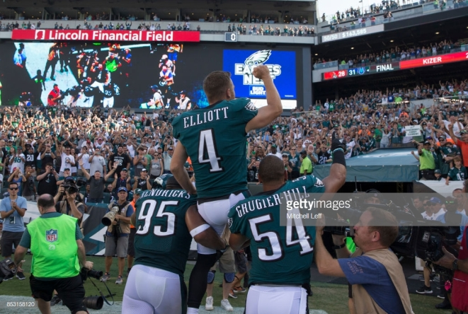 PHILADELPHIA, PA - SEPTEMBER 24: Kamu Grugier-Hill #54 and Mychal Kendricks #95 of the Philadelphia Eagles carry Jake Elliott #4 of the Philadelphia Eagles off the field after the game against the New York Giants at Lincoln Financial Field on September 24, 2017 in Philadelphia, Pennsylvania. The Eagles defeated the Giants 27-24. (Photo by Mitchell Leff/Getty Images)