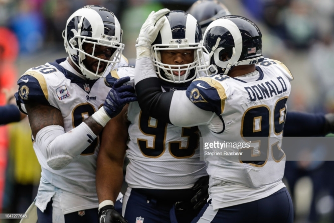 SEATTLE, WA - OCTOBER 07: Defensive tackle Ndamukong Suh #93 of the Los Angeles Rams celebrates a sack with teammates in the second half against the Seattle Seahawks at CenturyLink Field on October 7, 2018 in Seattle, Washington. (Photo by Stephen Brashear/Getty Images)