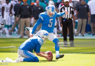MIAMI GARDENS, FL - OCTOBER 21: Detroit Lions Punter Sam Martin (6) holds the ball as Detroit Lions Kicker Matt Prater (5) kicks an extra point during the NFL football game between the Detroit Lions and the Miami Dolphins on October 21, 2018 at the Hard Rock Stadium in Miami Gardens, FL. (Photo by Doug Murray/Icon Sportswire via Getty Images)
