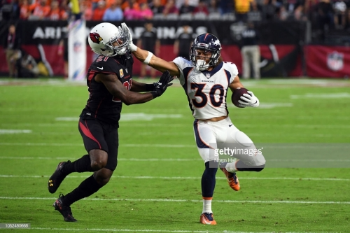 GLENDALE, AZ - OCTOBER 18: Running back Phillip Lindsay #30 of the Denver Broncos stiff arms cornerback Patrick Peterson #21 of the Arizona Cardinals during the first quarter at State Farm Stadium on October 18, 2018 in Glendale, Arizona. (Photo by Norm Hall/Getty Images)