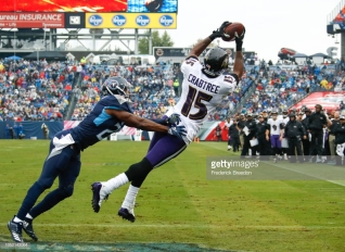 NASHVILLE, TN - OCTOBER 14: Michael Crabtree #15 of the Baltimore Ravens catches a pass to score a touchdown in the first quarter while defended by Malcolm Butler #21 of the Tennessee Titans at Nissan Stadium on October 14, 2018 in Nashville, Tennessee. (Photo by Frederick Breedon/Getty Images)