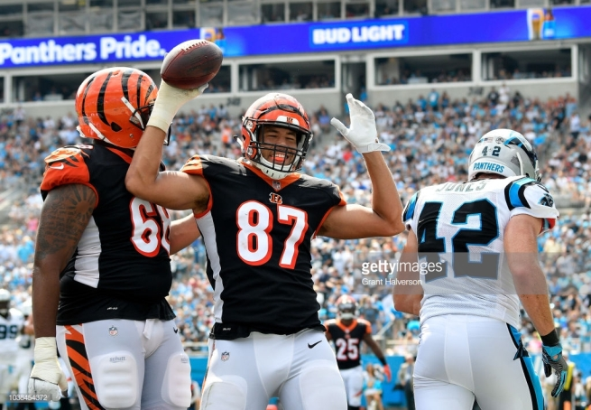 CHARLOTTE, NC - SEPTEMBER 23: C.J. Uzomah #87 of the Cincinnati Bengals celebrates a touchdown against the Carolina Panthers in the second quarter during their game at Bank of America Stadium on September 23, 2018 in Charlotte, North Carolina. (Photo by Grant Halverson/Getty Images)
