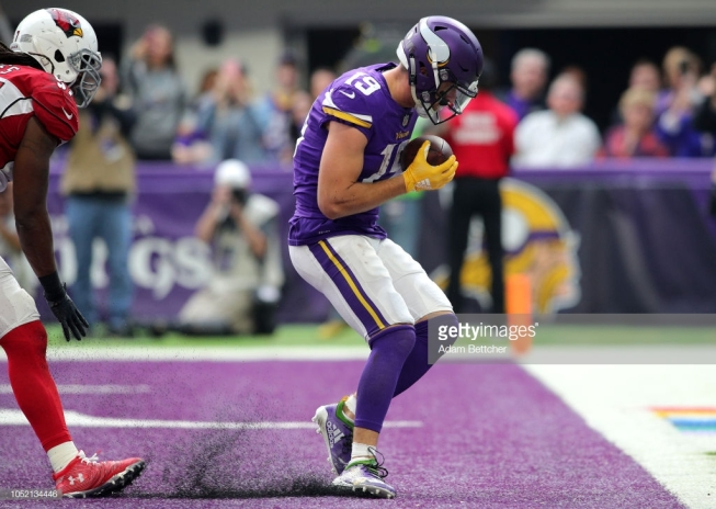 MINNEAPOLIS, MN - OCTOBER 14: Adam Thielen #19 of the Minnesota Vikings catches the ball in the endzone for a touchdown in the third quarter of the game against the Arizona Cardinals at U.S. Bank Stadium on October 14, 2018 in Minneapolis, Minnesota. (Photo by Adam Bettcher/Getty Images)