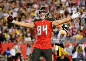 TAMPA, FL - SEPTEMBER 24: Cameron Brate #84 of the Tampa Bay Buccaneers reacts after scoring in the first quarter against the Pittsburgh Steelers on September 24, 2018 at Raymond James Stadium in Tampa, Florida. (Photo by Julio Aguilar/Getty Images)
