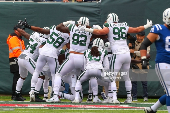 EAST RUTHERFORD, NJ - OCTOBER 14: New York Jets cornerback Morris Claiborne (21) celebrates with teammates after he intercepts a pass and scores a touchdown during the National Football League Game between the New York Jets and the Indianapolis Colts on October 14, 2018 at MetLife Stadium in East Rutherford, NJ. (Photo by Rich Graessle/Icon Sportswire via Getty Images)