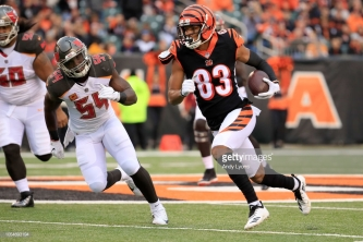 CINCINNATI, OH - OCTOBER 28: Tyler Boyd #83 of the Cincinnati Bengals runs the ball past Lavonte David #54 of the Tampa Bay Buccaneers during the first quarter at Paul Brown Stadium on October 28, 2018 in Cincinnati, Ohio. (Photo by Andy Lyons/Getty Images)