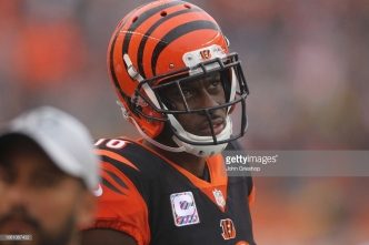CINCINNATI, OH - OCTOBER 14: A.J. Green #18 of the Cincinnati Bengals watches his team from the sidelines during the game against the Pittsburgh Steelers at Paul Brown Stadium on October 14, 2018 in Cincinnati, Ohio. The Steelers defeated the Bengals 28-21. (Photo by John Grieshop/Getty Images)