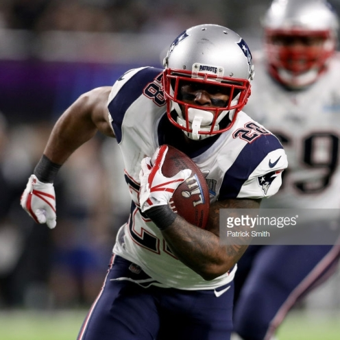 MINNEAPOLIS, MN - FEBRUARY 04: James White #28 of the New England Patriots runs for a 26-yard touchdown against the Philadelphia Eagles during the second quarter in Super Bowl LII at U.S. Bank Stadium on February 4, 2018 in Minneapolis, Minnesota. (Photo by Patrick Smith/Getty Images)
