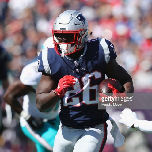 FOXBOROUGH, MA - SEPTEMBER 30: Sony Michel #26 of the New England Patriots carries the ball during the first half against the Miami Dolphins at Gillette Stadium on September 30, 2018 in Foxborough, Massachusetts. (Photo by Maddie Meyer/Getty Images)