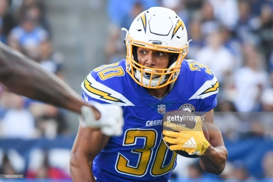 CARSON, CA - NOVEMBER 25: Running back Austin Ekeler #30 of the Los Angeles Chargers runs after his catch in front of defensive back David Amerson #38 of the Arizona Cardinals during the third quarter at StubHub Center on November 25, 2018 in Carson, California. (Photo by Harry How/Getty Images)