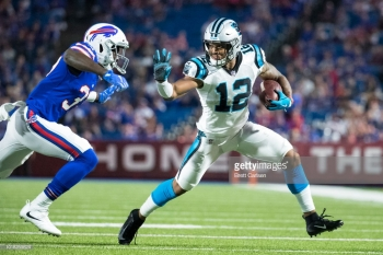 ORCHARD PARK, NY - AUGUST 09: DJ Moore #12 of the Carolina Panthers attempts to fend off Kelcie McCray #37 of the Buffalo Bills while carrying the ball during the second half at New Era Field on August 9, 2018 in Orchard Park, New York. Carolina defeats Buffalo in the preseason game 28-23. (Photo by Brett Carlsen/Getty Images)