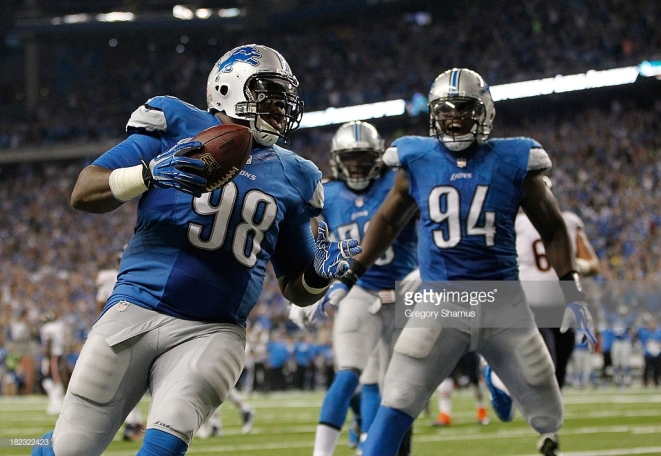 DETROIT, MI - SEPTEMBER 29: Nick Fairley #98 of the Detroit Lions celebrates a third quarter touchdown with Ezekiel Ansah #94 while playing the Chicago Bears at Ford Field on September 29, 2013 in Detroit, Michigan. (Photo by Gregory Shamus/Getty Images)